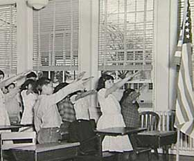 American children saluting flag during Pledge of Allegiance (prior to WWII).  Yes, this is the salute they used.